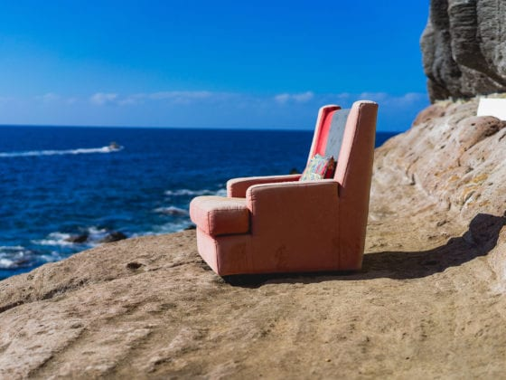 Chair sits on a cliff facing out to sea